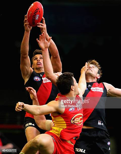 Mark Baguley of the Bombers takes a mark as Jobe Watson competes for the ball during the round 22 AFL match between the Essendon Bombers and the Gold...