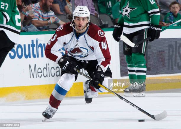 Mark Barberio of the Colorado Avalanche handles the puck against the Dallas Stars at the American Airlines Center on April 8 2017 in Dallas Texas