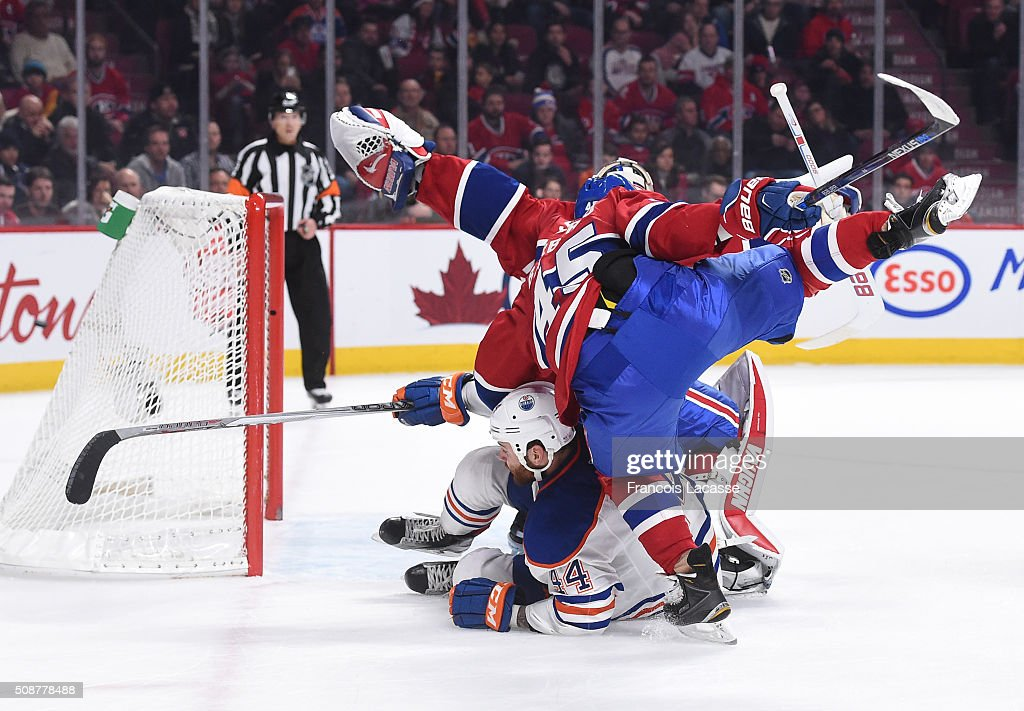 <a gi-track='captionPersonalityLinkClicked' href=/galleries/search?phrase=Mark+Barberio&family=editorial&specificpeople=4819242 ng-click='$event.stopPropagation()'>Mark Barberio</a> #45 of the Montreal Canadiens and <a gi-track='captionPersonalityLinkClicked' href=/galleries/search?phrase=Zack+Kassian&family=editorial&specificpeople=4604939 ng-click='$event.stopPropagation()'>Zack Kassian</a> #44 of the Edmonton Oilers collide in the NHL game at the Bell Centre on February 6, 2016 in Montreal, Quebec, Canada.