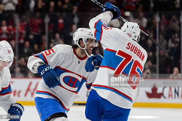 Mark Barberio of the Montreal Canadiens celebrates his first goal of the season with teammate PK Subban during the NHL game against the Boston Bruins...