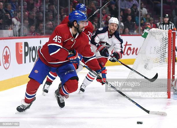 Mark Barberio of the Montreal Canadiens looks to pass the puck against the Columbus Blue Jackets in the NHL game at the Bell Centre on January 26...