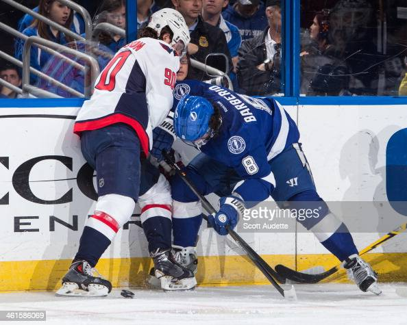 Mark Barberio of the Tampa Bay Lightning battles for the puck against Marcus Johansson of the Washington Capitals during the first period at the...
