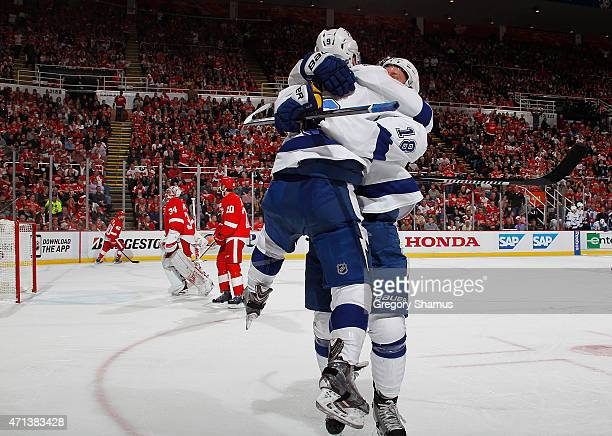 Mark Barberio of the Tampa Bay Lightning celebrates his second period goal with Ondrej Palat in front of Jimmy Howard and Drew Miller of the Detroit...