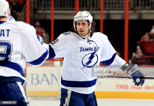 Mark Barberio of the Tampa Bay Lightning celebrates with teammates after scoring his 2nd goal of the game during their NHL contest against the...
