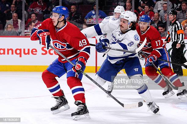 Mark Barberio of the Tampa Bay Lightning defends against Michael Bournival of the Montreal Canadiens during the NHL game at the Bell Centre on...