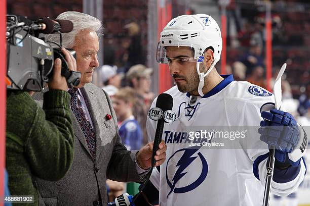 Mark Barberio of the Tampa Bay Lightning is interviewed during warmups prior to a game against the Ottawa Senators at Canadian Tire Centre on April 2...