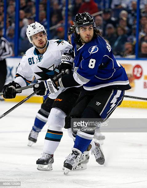 Mark Barberio of the Tampa Bay Lightning tangles with Tyler Kennedy of the San Jose Sharks at the Tampa Bay Times Forum on January 18 2014 in Tampa...