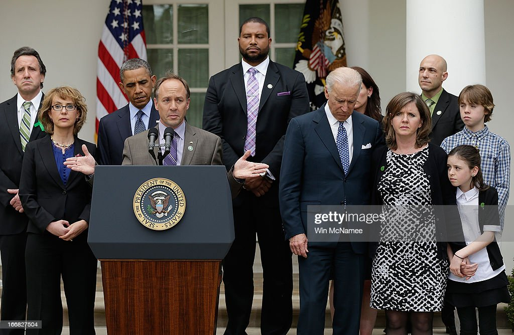 Mark Barden, the father of a victim at Sandy Hook Elementary School, joins U.S. President Barack Obama and Vice President Joe Biden in making a statement on gun violence in the Rose Garden of the White House on April 17, 2013 in Washington, DC. Earlier today the Senate defeated a bi-partisan measure to expand background checks for gun sales. Also pictured are family members of gun violence victims, and victims of gun violence, Gabby Giffords, Jimmy Greene, Nicole Hockley, Jeremy Richman, Neil Heslin, Jackie Barden, Natalie Barden and James Barden.