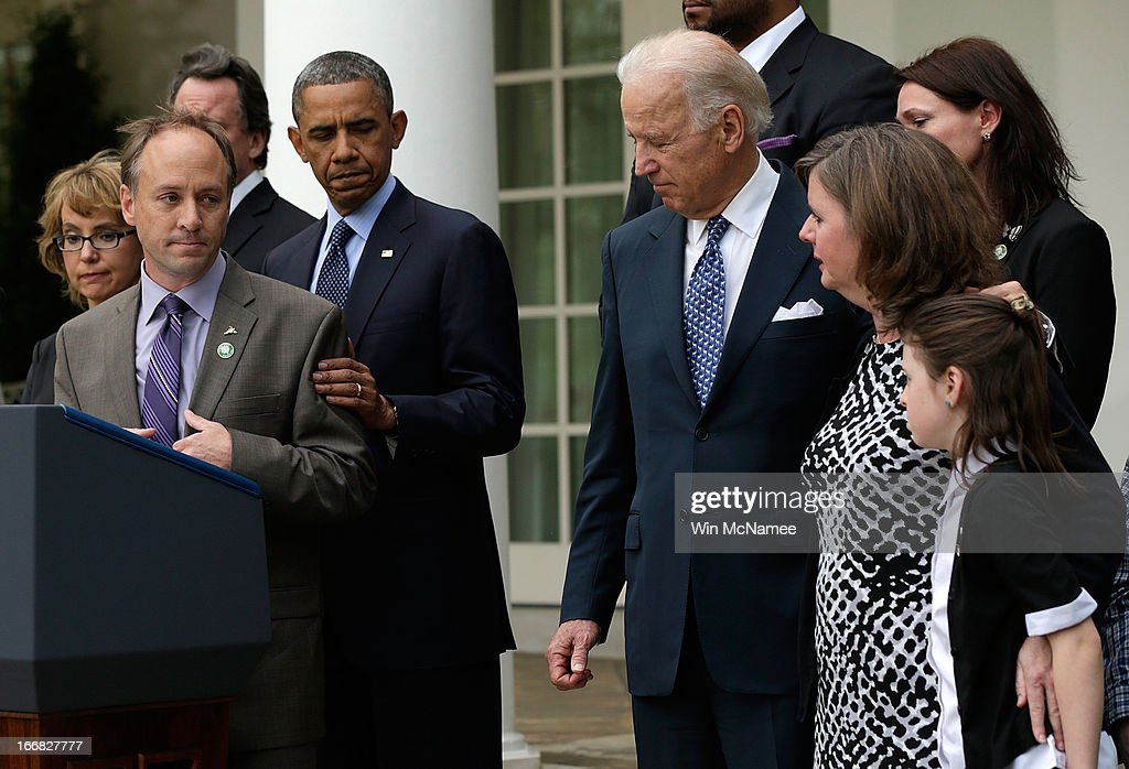 Mark Barden, the father of a victim at Sandy Hook Elementary School, joins U.S. President <a gi-track='captionPersonalityLinkClicked' href=/galleries/search?phrase=Barack+Obama&family=editorial&specificpeople=203260 ng-click='$event.stopPropagation()'>Barack Obama</a> and Vice President Joe Biden in making a statement on gun violence in the Rose Garden of the White House on April 17, 2013 in Washington, DC. Earlier today the Senate defeated a bi-partisan measure to expand background checks for gun sales. Also pictured (L) is former Rep. Gabby Giffords.