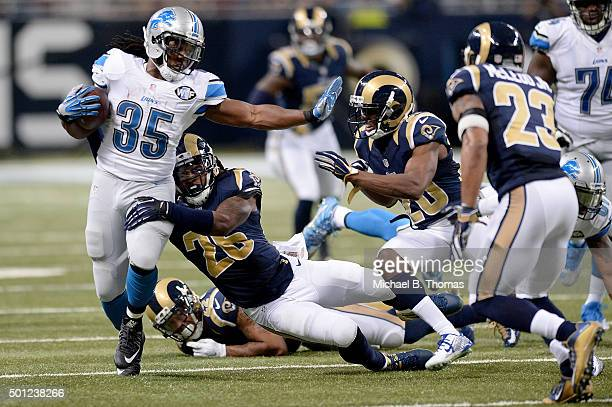 Mark Barron of the St Louis Rams attempts to tackle Joique Bell of the Detroit Lions as he carries the ball in the third quarter at the Edward Jones...