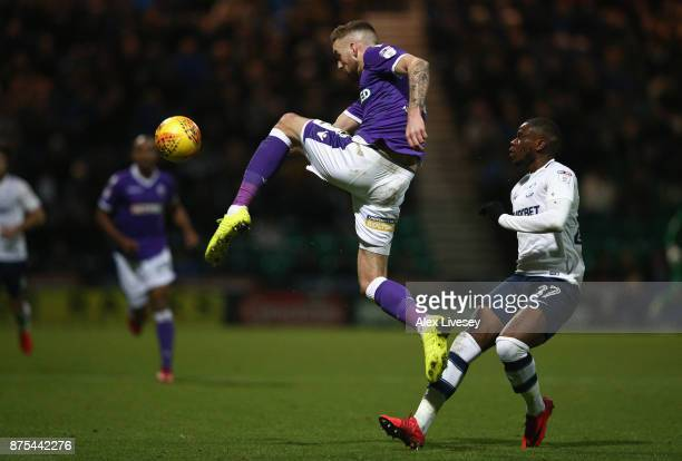 Mark Beevers of Bolton Wanderers clears the ball ahead of Stephy Mavididi of Preston North End during the Sky Bet Championship match between Preston...