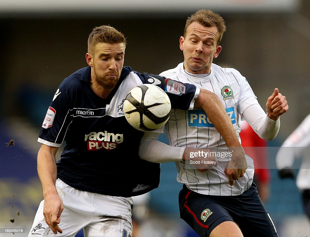 Mark Beevers of Millwall (L) in action with Jordan Rhodes of Blackburn during the FA Cup Sixth round match between Millwall and Blackburn Rovers at The Den on March 10, 2013 in London, England.