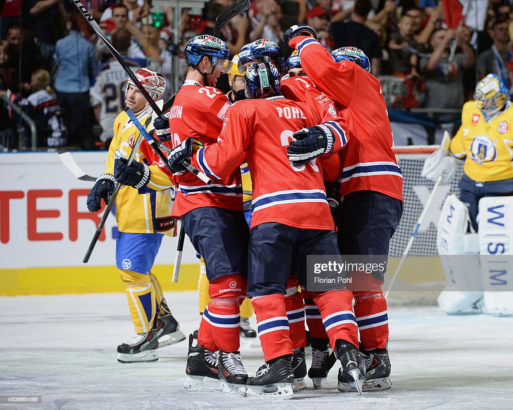 Mark Bell #17 of Eisbären Berlin celebrates with team-mates after scoring a goal during the Champions Hockey League group stage game between Eisbaeren Berlin and HC Zlin on August 22, 2014 in Berlin, Germany.