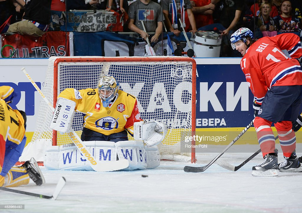 Mark Bell #17 of Eisbären Berlin scores their first goal past Goalie Lubos Horcicka #79 of PSG Zlin during the Champions Hockey League group stage game between Eisbaeren Berlin and HC Zlin on August 22, 2014 in Berlin, Germany.