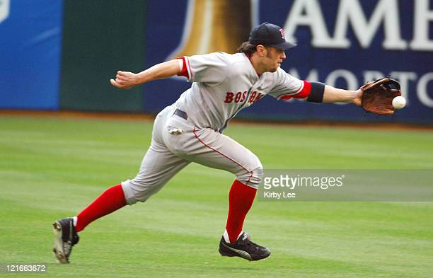 Mark Bellhorn of the Boston Red Sox stretches for a ground ball by Mark Ellis of the Oakland Athletics during 136 loss at McAfee Coliseum in Oakland...