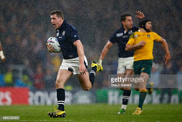 Mark Bennett of Scotland breaks to score his teams third try during the 2015 Rugby World Cup Quarter Final match between Australia and Scotland at...