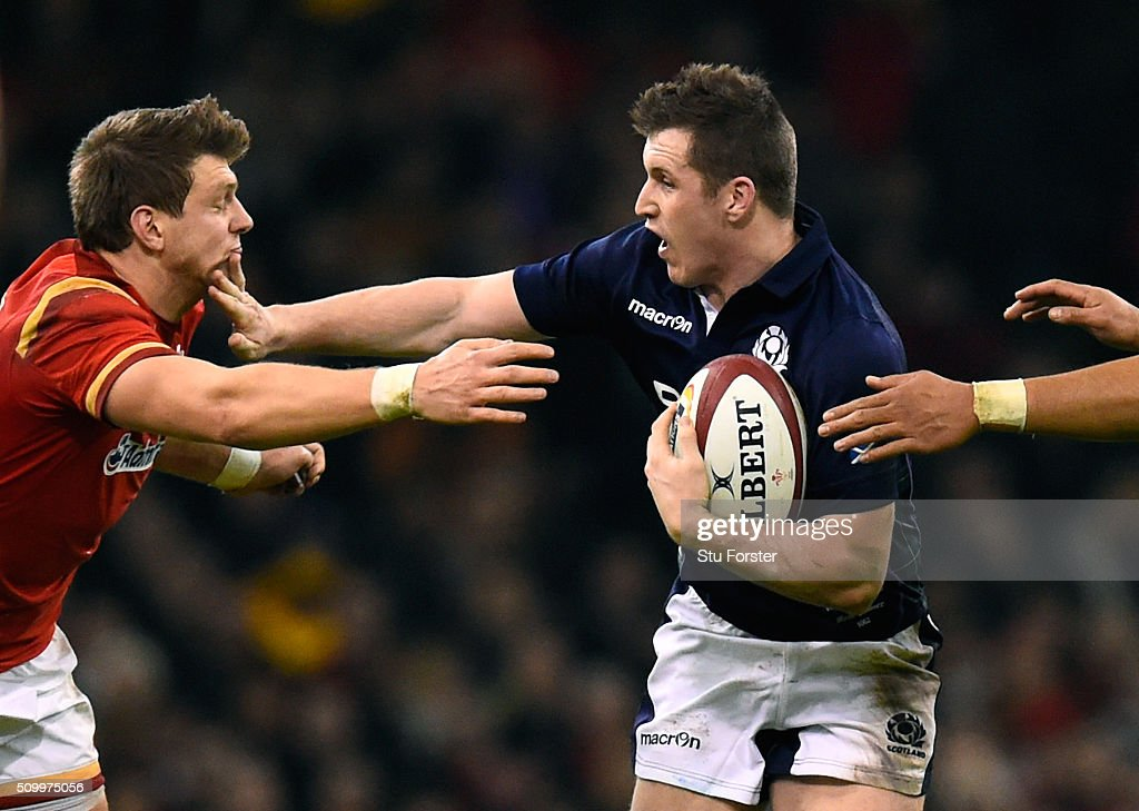 Mark Bennett of Scotland hands off <a gi-track='captionPersonalityLinkClicked' href=/galleries/search?phrase=Dan+Biggar&family=editorial&specificpeople=5607224 ng-click='$event.stopPropagation()'>Dan Biggar</a> of Wales during the RBS Six Nations match between Wales and Scotland at the Principality Stadium on February 13, 2016 in Cardiff, Wales.