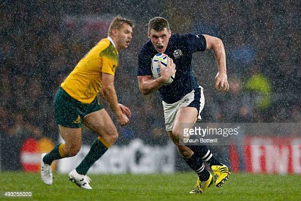 Mark Bennett of Scotland makes a break during the 2015 Rugby World Cup Quarter Final match between Australia and Scotland at Twickenham Stadium on...