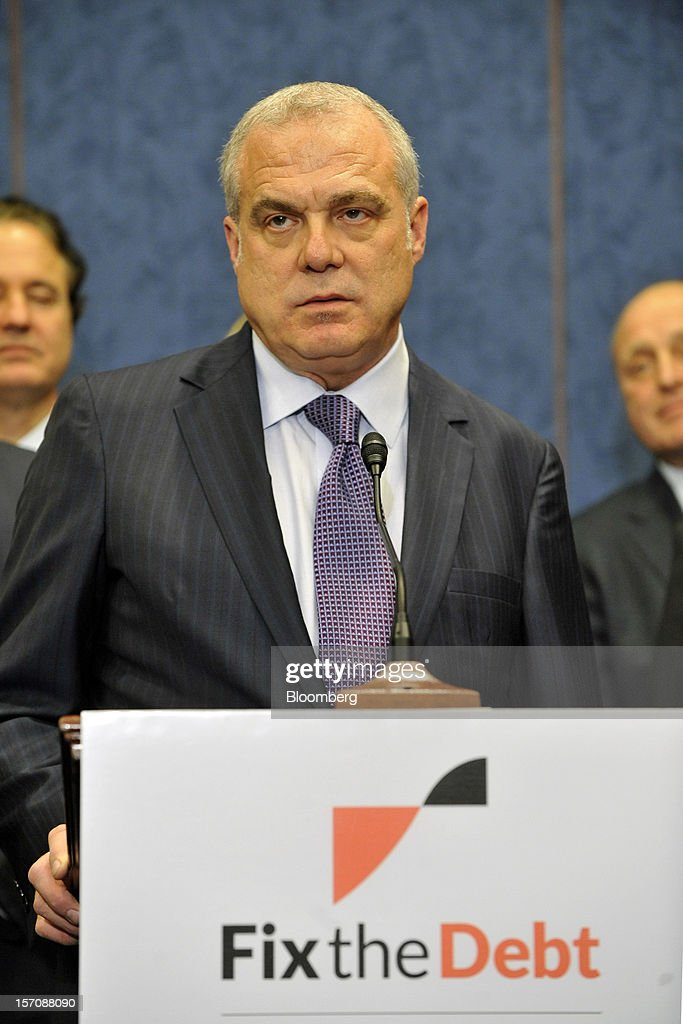 Mark Bertolini, chairman and chief executive officer of Aetna Inc., speaks during a news conference at the U.S. Capitol in Washington, D.C., U.S., on Wednesday, Nov. 28, 2012. Business executives pressing for a solution to the so-called fiscal cliff made their case at the White House and the Capitol a day after Senate Majority Leader Harry Reid lamented the lack of progress toward a deal. Photographer: Jay Mallin/Bloomberg via Getty Images