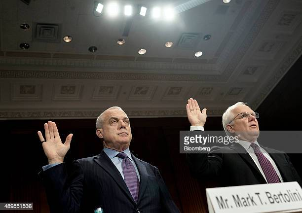 Mark Bertolini chief executive officer of Aetna Inc left and Joseph Swedish chief executive officer of Anthem Inc are sworn in before testifying at a...