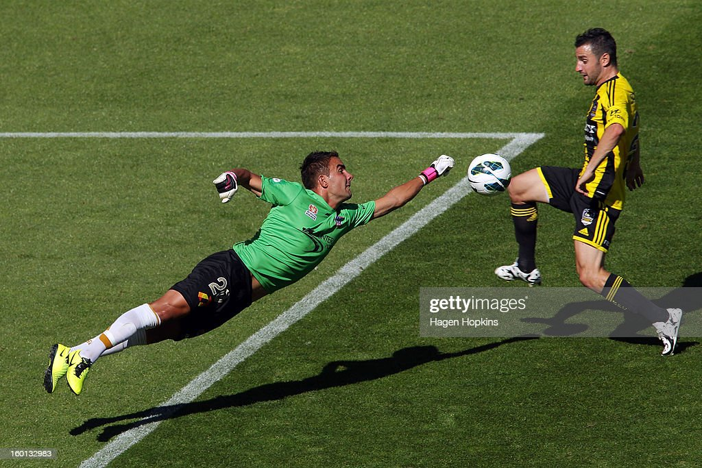Mark Birighitti of the Jets attempts to save the ball under pressure from Dani Sanchez of the Phoenix during the round 18 A-League match between the Wellington Phoenix and the Newcastle Jets at Westpac Stadium on January 27, 2013 in Wellington, New Zealand.