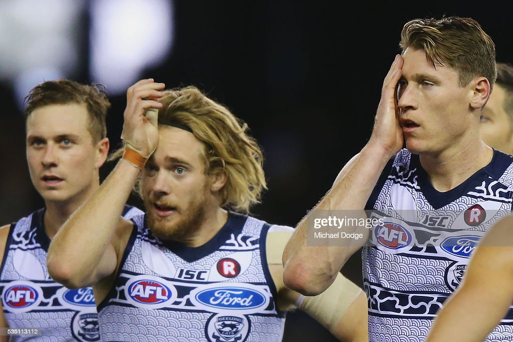 Mark Blicavs of the Cats (R) and Cameron Guthrie react after being down at half time during the round 10 AFL match between the Carlton Blues and the Geelong Cats at Etihad Stadium on May 29, 2016 in Melbourne, Australia.