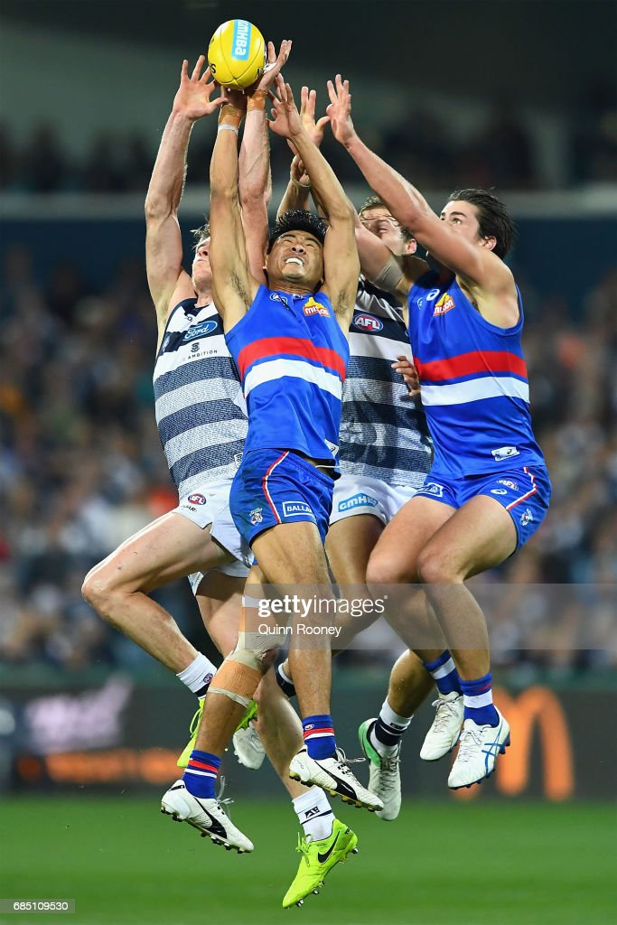 Mark Blicavs of the Cats and Lin Jong of the Bulldogs compete for a mark during the round nine AFL match between the Geelong Cats and the Western Bulldogs at Simonds Stadium on May 19, 2017 in Geelong, Australia.
