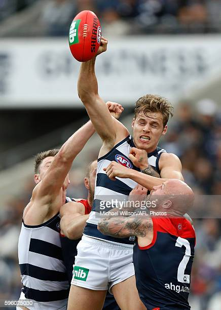 Mark Blicavs of the Cats Jake Kolodjashnij of the Cats and Nathan Jones of the Demons compete for the ball during the 2016 AFL Round 23 match between...
