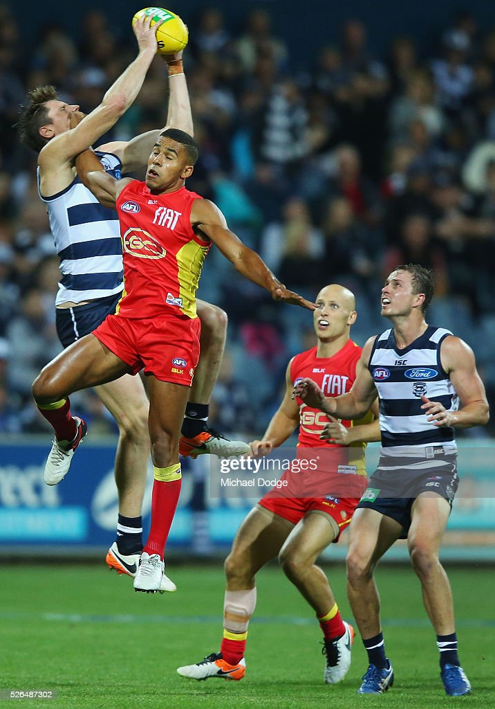 Mark Blicavs of the Cats marks the ball against Took Miller of the Suns during the round six AFL match between the Geelong Cats and the Gold Coast Suns at Simonds Stadium on April 30, 2016 in Geelong, Australia.