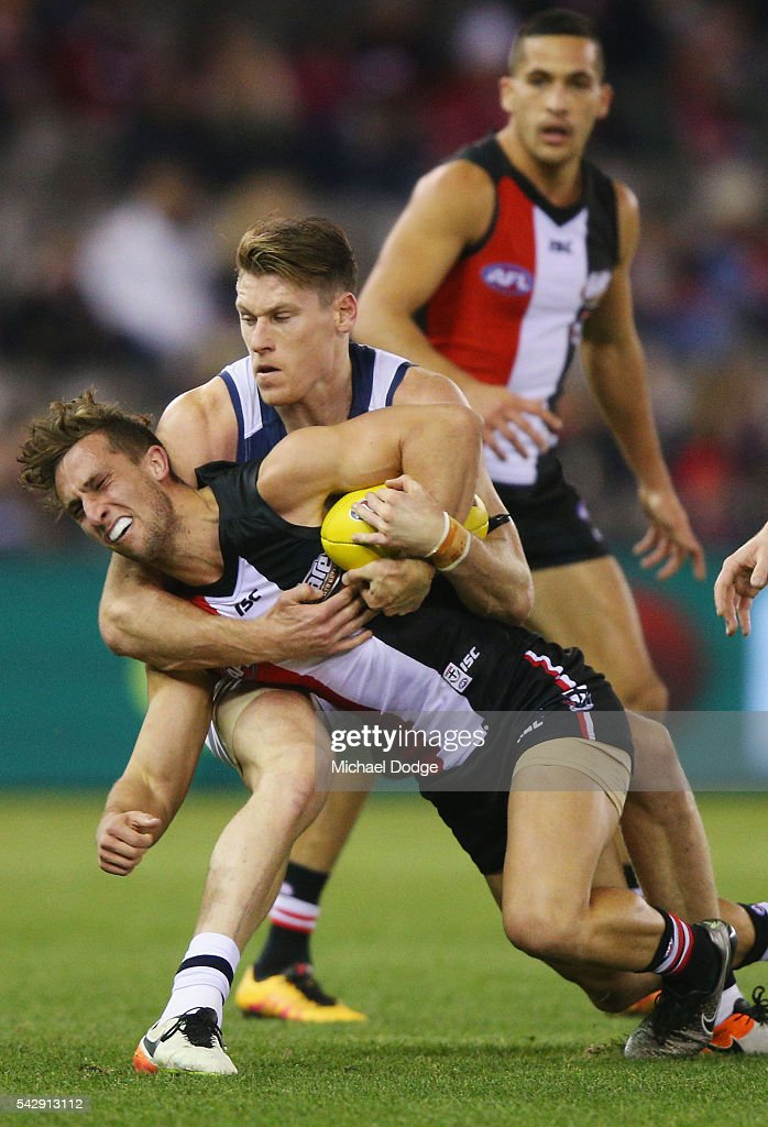 Mark Blicavs of the Cats tackles Luke Dunstan of the Saints during the round 14 AFL match between the St Kilda Saints and the Geelong Cats at Etihad Stadium on June 25, 2016 in Melbourne, Australia.