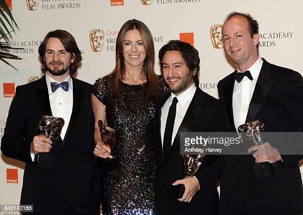 Mark Boal Kathryn Bigelow Greg Shapiro and Nicholas Chartier pose with the award for Best Film The Hurt Locker during the Orange British Academy Film...