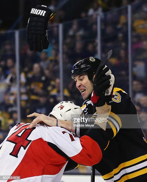 Mark Borowiecki of the Ottawa Senators and Zdeno Chara of the Boston Bruins exchange punches during the second period at TD Garden on December 29...