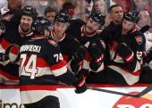 Mark Borowiecki of the Ottawa Senators celebrates his first career NHL goal with teammates Matt Kassian Mika Zibanejad Chris Phillips and Eric Gryba...