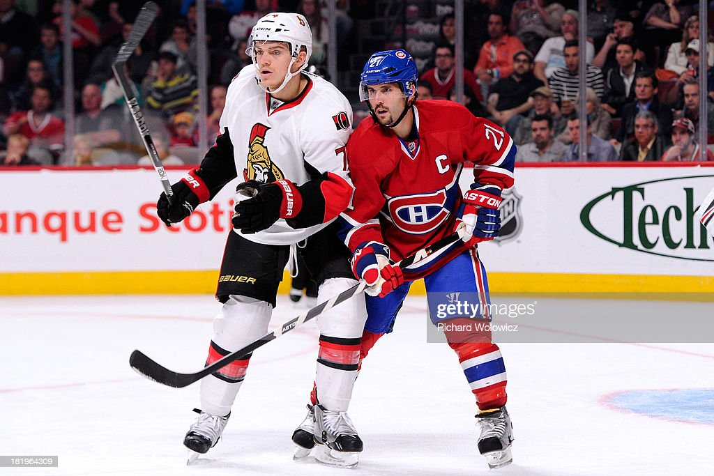 <a gi-track='captionPersonalityLinkClicked' href=/galleries/search?phrase=Mark+Borowiecki&family=editorial&specificpeople=5409020 ng-click='$event.stopPropagation()'>Mark Borowiecki</a> #74 of the Ottawa Senators defends against <a gi-track='captionPersonalityLinkClicked' href=/galleries/search?phrase=Brian+Gionta&family=editorial&specificpeople=202116 ng-click='$event.stopPropagation()'>Brian Gionta</a> #21 of the Montreal Canadiens during an NHL preseason game at the Bell Centre on September 26, 2013 in Montreal, Quebec, Canada. The Canadiens defeated the Senators 3-1.