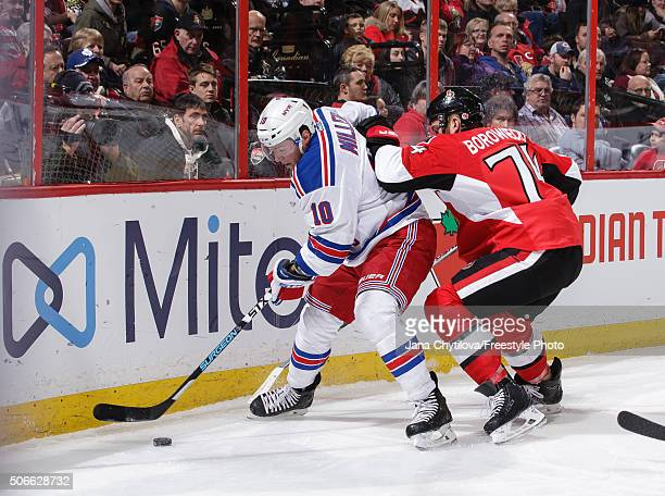 Mark Borowiecki of the Ottawa Senators defends against JT Miller of the New York Rangers during an NHL game at Canadian Tire Centre on January 24...