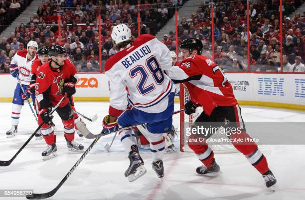 Mark Borowiecki of the Ottawa Senators pushes Nathan Beaulieu of the Montreal Canadiens as he defends the net at Canadian Tire Centre on March 18...