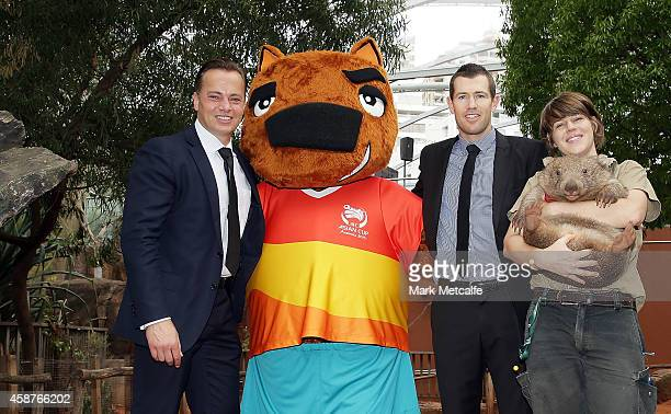 Mark Bosnich and Brett Emerton pose with AFC Asian Cup official mascot Nutmeg the wombat and a wombat at Wild Life Sydney Zoo on November 11 2014 in...