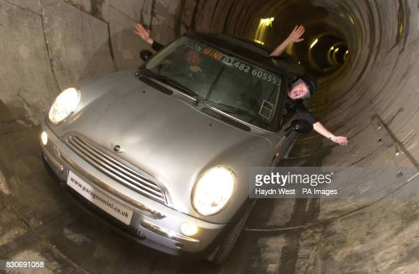 Mark Bostock and Russell Barrett from Paragon Mini drive one of the new BMW Mini Cooper along a stretch of newlyconstructed sewer in Hull mirroring...