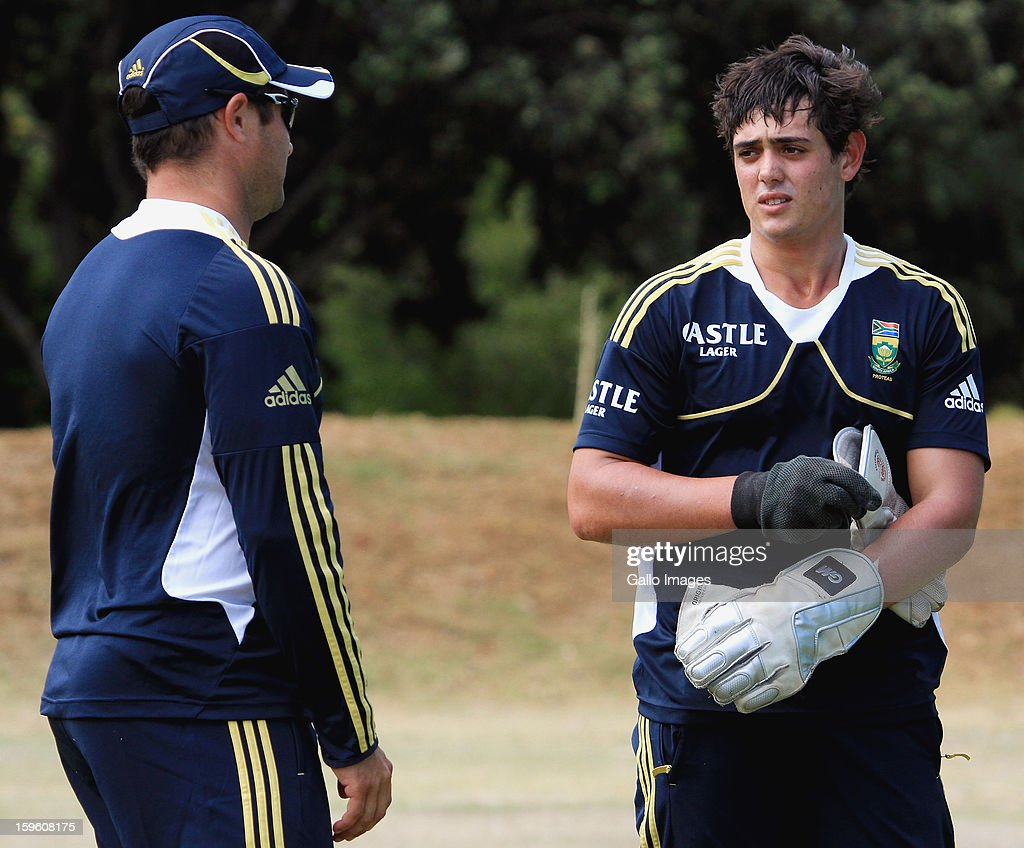 Mark Boucher (L) chats to Quinton de Kock during the South African national cricket team nets session and press conference at Claremont Cricket Club on January 17, 2013 in Cape Town, South Africa.