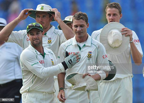 Mark Boucher congratulates south Africa teammate Dale Steyn after their win by an innings and 6 runs during day 4 of the 1st test between India and...