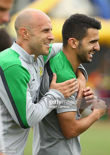 Mark Bresciano and Aziz Behich of Australia are seen during an Australian Socceroos training session at Collingwood training Ground on January 4 2015...