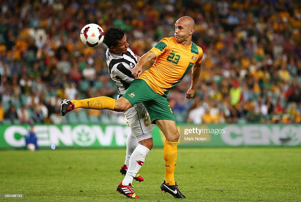 Mark Bresciano of Australia and Jose Cubero of Costa Rica contest possession during the international friendly match between the Australian Socceroos and Costa Rica at Allianz Stadium on November 19, 2013 in Sydney, Australia.