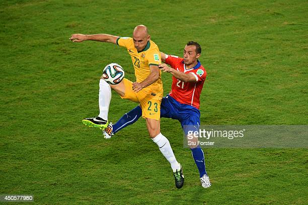 Mark Bresciano of Australia is challenged by Marcelo Diaz of Chile during the 2014 FIFA World Cup Brazil Group B match between Chile and Australia at...