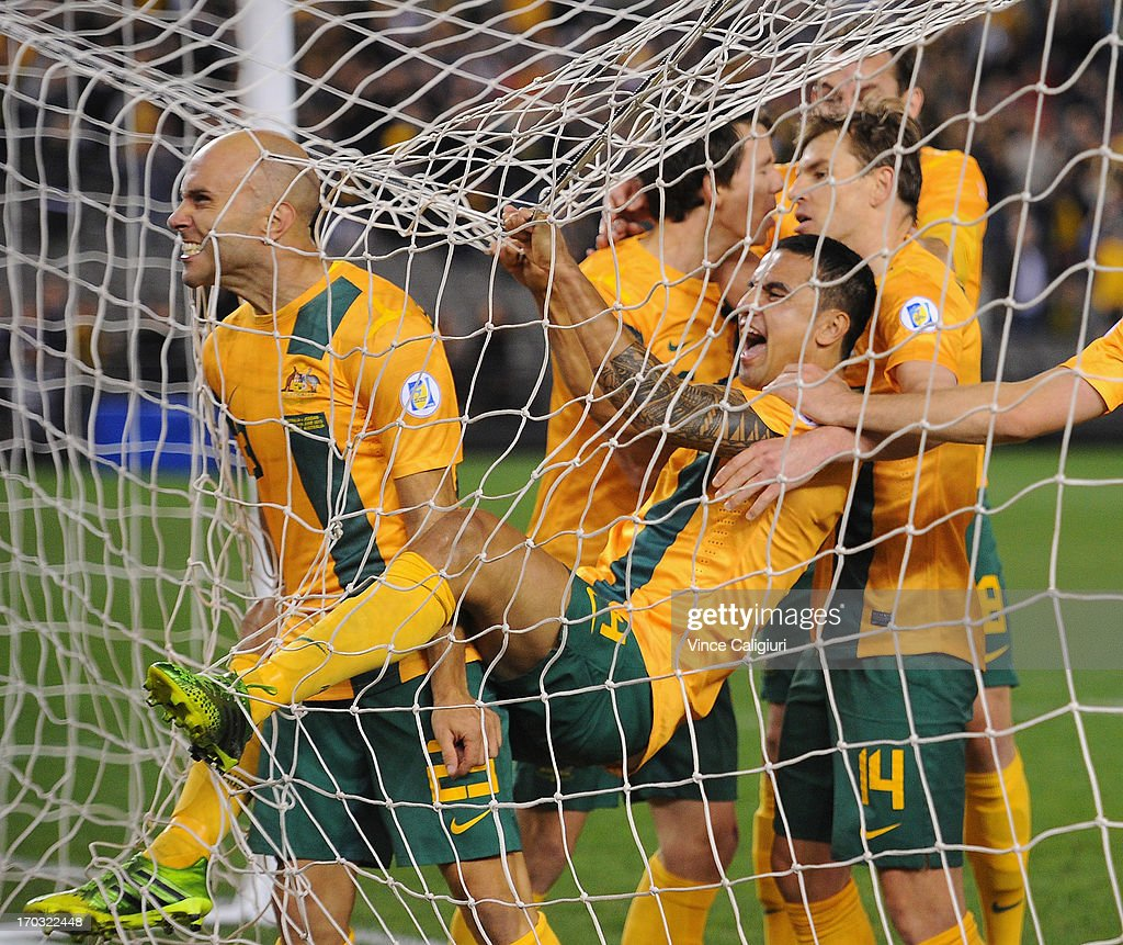 Mark Bresciano of Australia is congratulated by team mates after scoring a goal during the FIFA World Cup Qualifier match between the Australian Socceroos and Jordan at Etihad Stadium on June 11, 2013 in Melbourne, Australia.