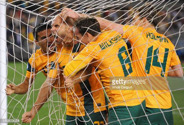 Mark Bresciano of Australia is congratulated by team mates after scoring a goal during the FIFA World Cup Qualifier match between the Australian...