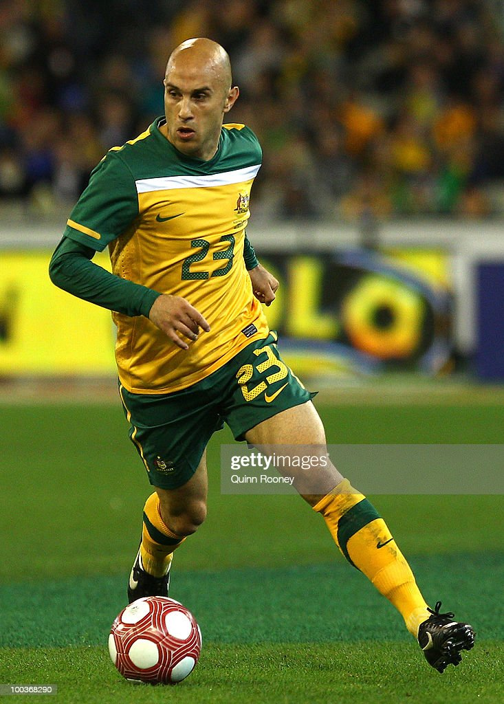 Mark Bresciano of Australia passes the ball during the 2010 FIFA World Cup Pre-Tournament match between the Australian Socceroos and the New Zealand All Whites at Melbourne Cricket Ground on May 24, 2010 in Melbourne, Australia.
