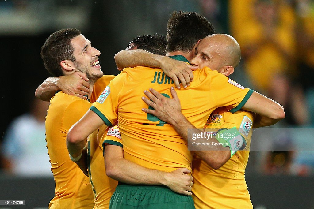 Mark Bresciano of the Socceroos congratulates team mate Tomi Juric after scoring a goal during the 2015 Asian Cup match between Oman and Australia at ANZ Stadium on January 13, 2015 in Sydney, Australia.