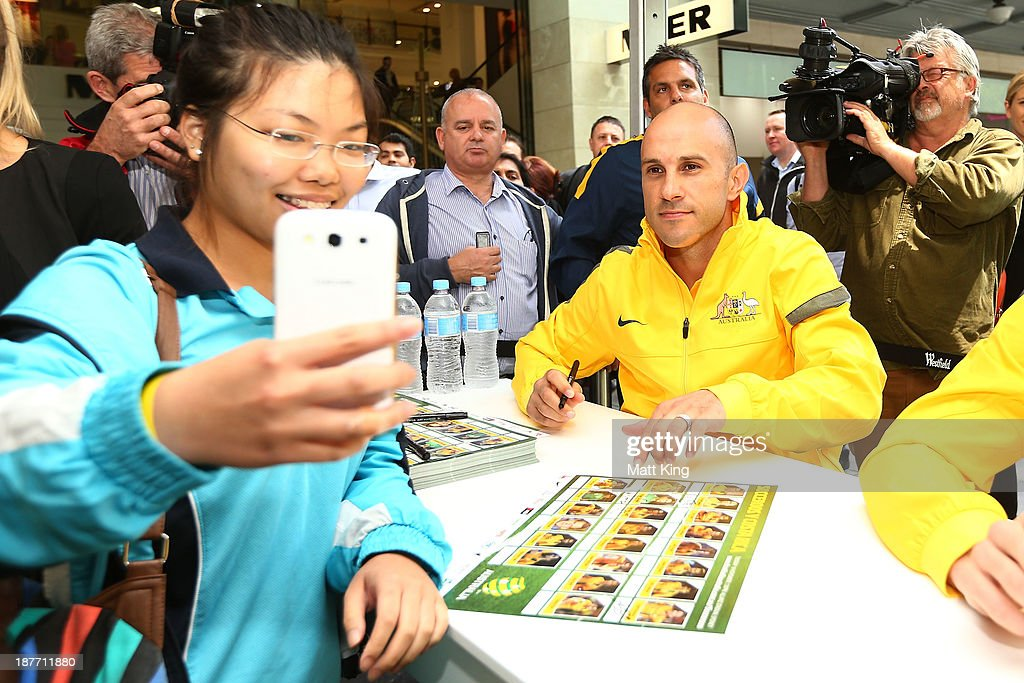 Mark Bresciano poses for a member of the public during an Australian Socceroos public appearance at Westfield Sydney on November 12, 2013 in Sydney, Australia.