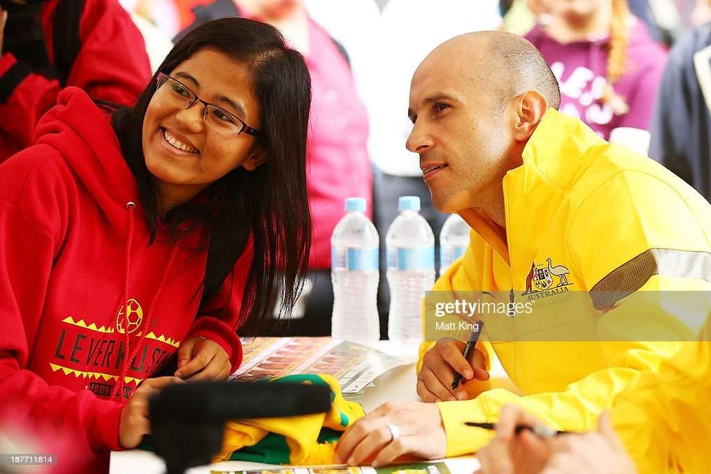 Mark Bresciano poses with a member of the public during an Australian Socceroos public appearance at Westfield Sydney on November 12, 2013 in Sydney, Australia.