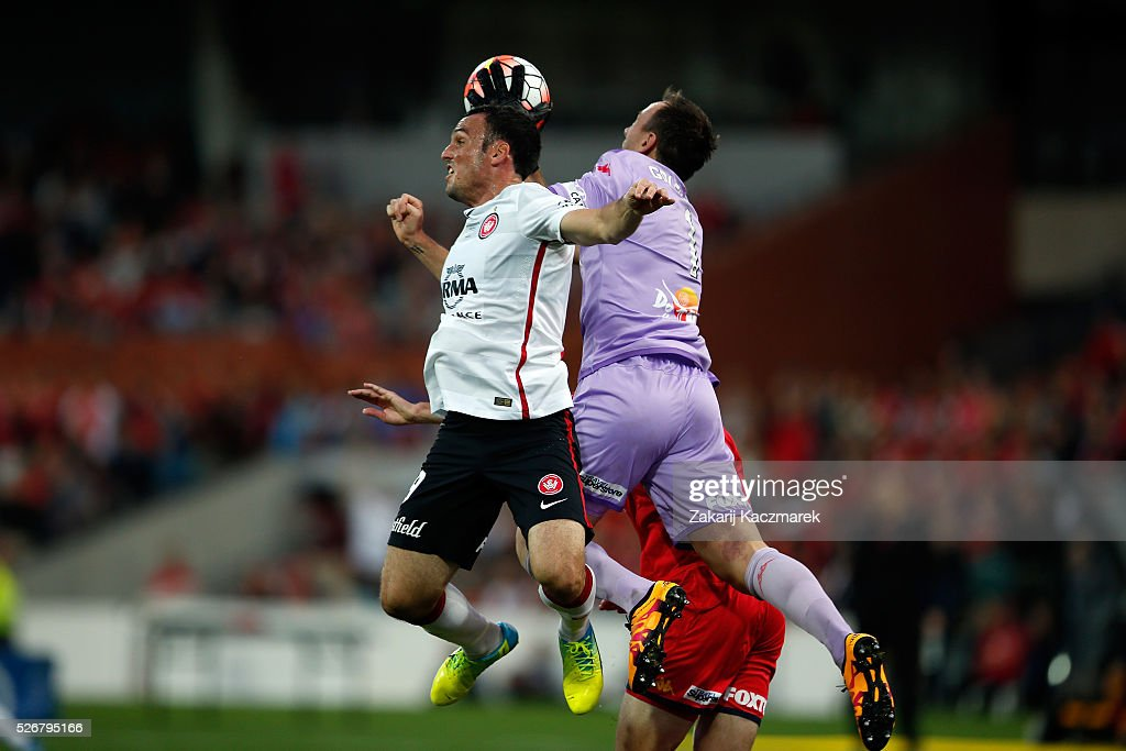 Mark Bridge of the Wanderers and United goalkeeper Eugene Galekovic challenge for the ball during the 2015/16 A-League Grand Final match between Adelaide United and the Western Sydney Wanderers at Adelaide Oval on May 1, 2016 in Adelaide, Australia.